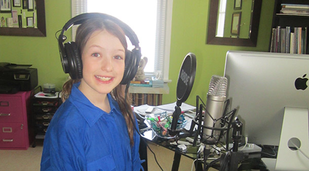 Student recording her voice during music lessons